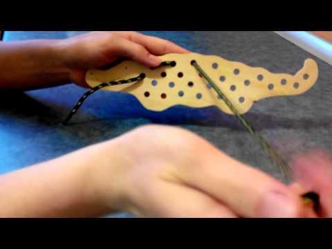Развитие моторики - игра шнуровки