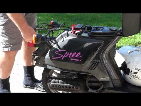 How To FIX a FLAT TIRE  on a HONDA SPREE Scooter ~ REMOVE the REAR Wheel on a moped