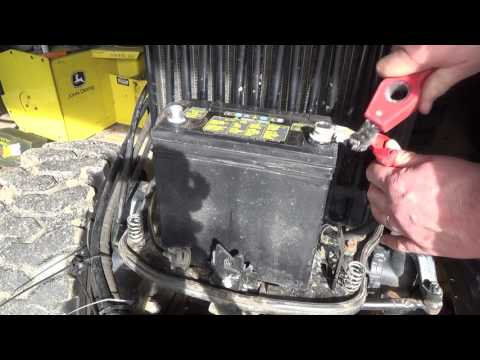 Tractor battery maintenence and constructing a metal melting foundry lid top
