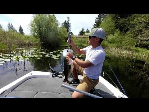 Adrian catching his Personal best Largemouth bass