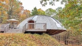 A UFO to call your own: House shaped like a flying saucer that rotates using 'passive solar energy