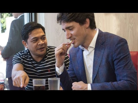 Trudeau snacks on fries at Manila Jollibee restaurant