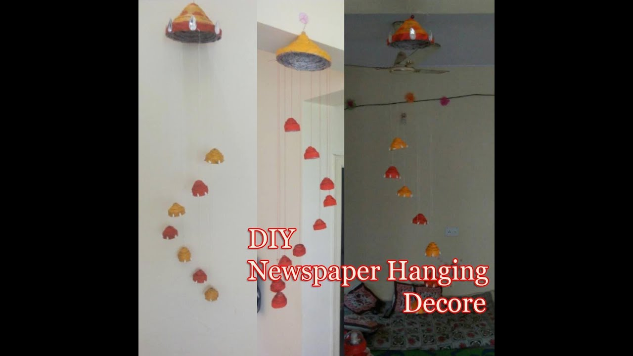 Newspaper craft ideas diy wind chime newspaper wall for Wall hanging designs with waste material
