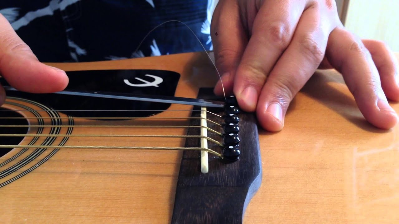 how to remove bridge pins easily using a spoon acoustic guitar youtube. Black Bedroom Furniture Sets. Home Design Ideas