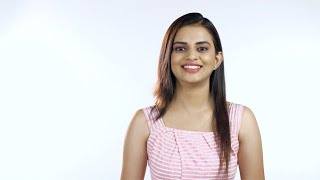 Young attractive girl happily smiling in casual wear against the white background