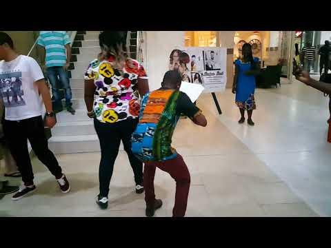 Ghanaian Artist Jumping and drawing