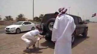 Nissan patrol pulls an 18 wheeler out of sand
