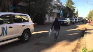 وكالة قاسيون  لحظة وصول المساعدات الأممية الى حي الوعر بحمص 5-12-2015