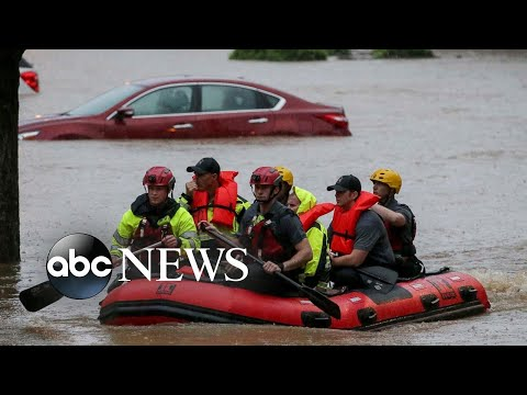 Alabama flooding, a policeman's funeral and new U.S. citizens: World in Photos, May 5