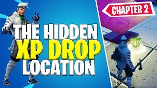 Search the XP Drop Hidden in the Chaos Rising Loading Screen Challenge Location in Fortnite Chapter2