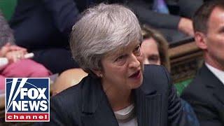 Theresa May postpones Brexit vote