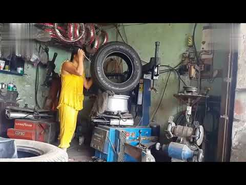 Woman doing kick ass work at a China Tire Repair Shop