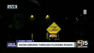 Water floods streets in Queen Creek