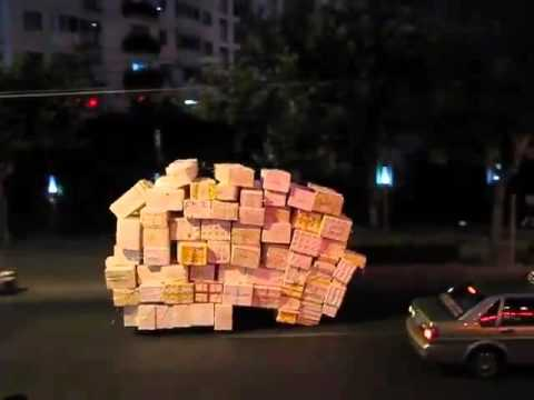 Overloaded tricycle spotted moving through the downtown streets in Shanghai