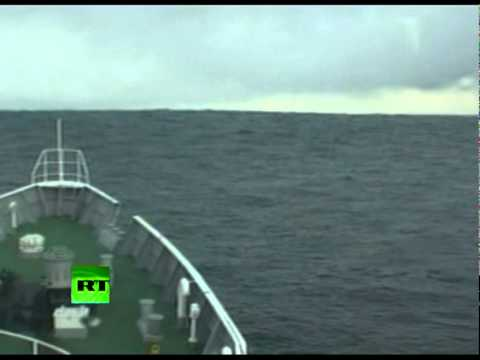 Tsunami Climbing: Incredible video of ship heading into wave