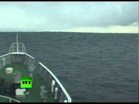 Tsunami Climbing: Incredible video of ship heading into wave in Japan