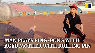 Man in China plays ping-pong with 82-year-old mother using a rolling pin