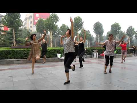 North Asia Bicycle Tour - China Xi-An square (People and one drunken man dancing at 6:00 AM)