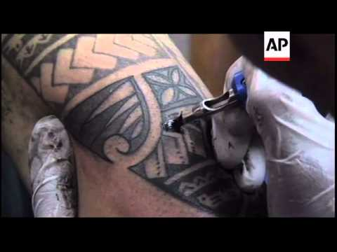 328e8e774 Traditional and modern tattoos popular on island. AP Archive