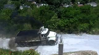 Mack Granite CV713 Dump Truck Climbing Hill Loaded With Asphalt