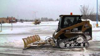 Cat 247B Plowing Sidewalk