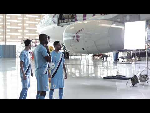 Behind the camera at the Qatar Airways aircraft hangar with Al Sadd SC