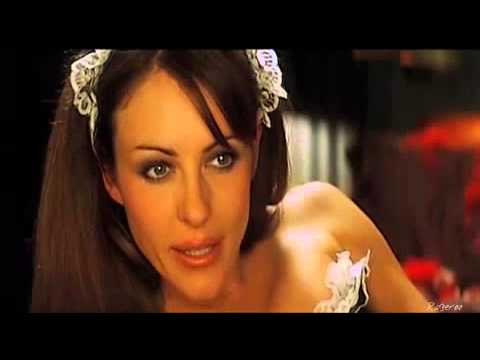 Elizabeth Hurley in a French maids outfit