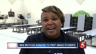 Elementary students surprised with new bikes