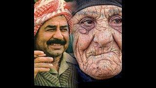 شآهد إمرأة عجوز تعطي صدآم حسين كيس من الأموال..!!