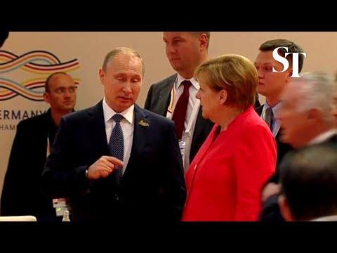 Angela Merkel gives Vladimir Putin epic eye roll