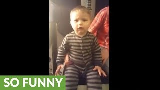 Baby on vibrating workout machine makes comical noises
