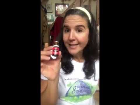 Installing a roller ball on Young Living essential oil and making a tension relief roller.