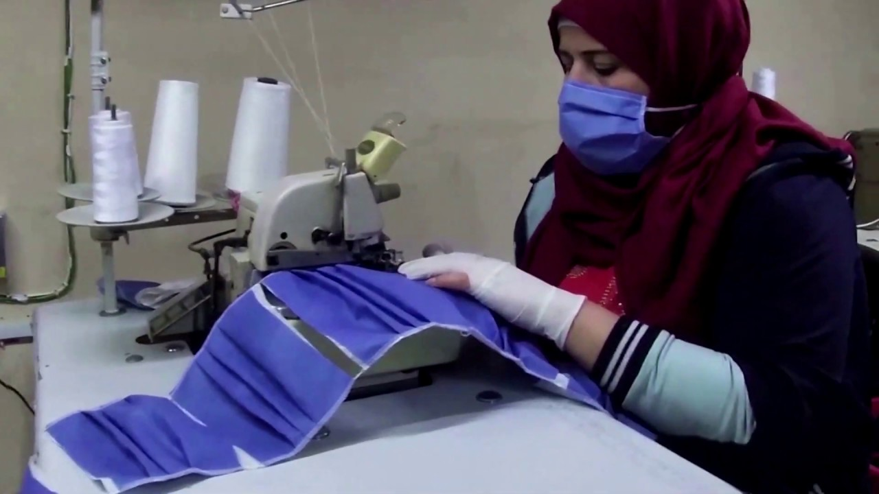 Syrian tailor switches from ball gowns to medical ones