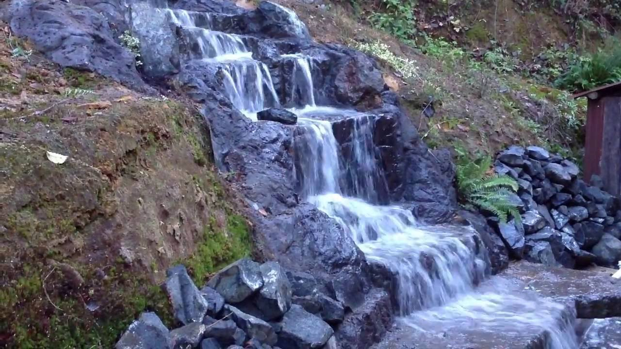 12 foot homemade waterfall home made from concrete - How to build a swimming pool waterfall ...