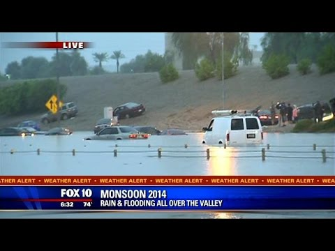 WATCH: Flooding on I-10, cars stuck underwater