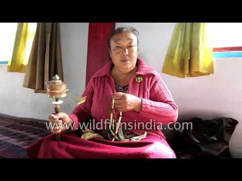 Beauty of Buddhism: Women use prayer wheels and chant in Kewzing Monastery, Sikkim