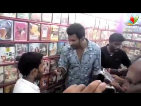 Vishal Raids Video Shop in Tirupur; Finds Pirated CDs of 'Poojai' and 'Kaththi'   Thiruttu VCD