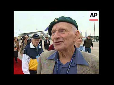 French welcome group of US veterans arriving at airport
