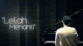 Download Bagas Ran - Lelah Menanti (Official Lyric Video)