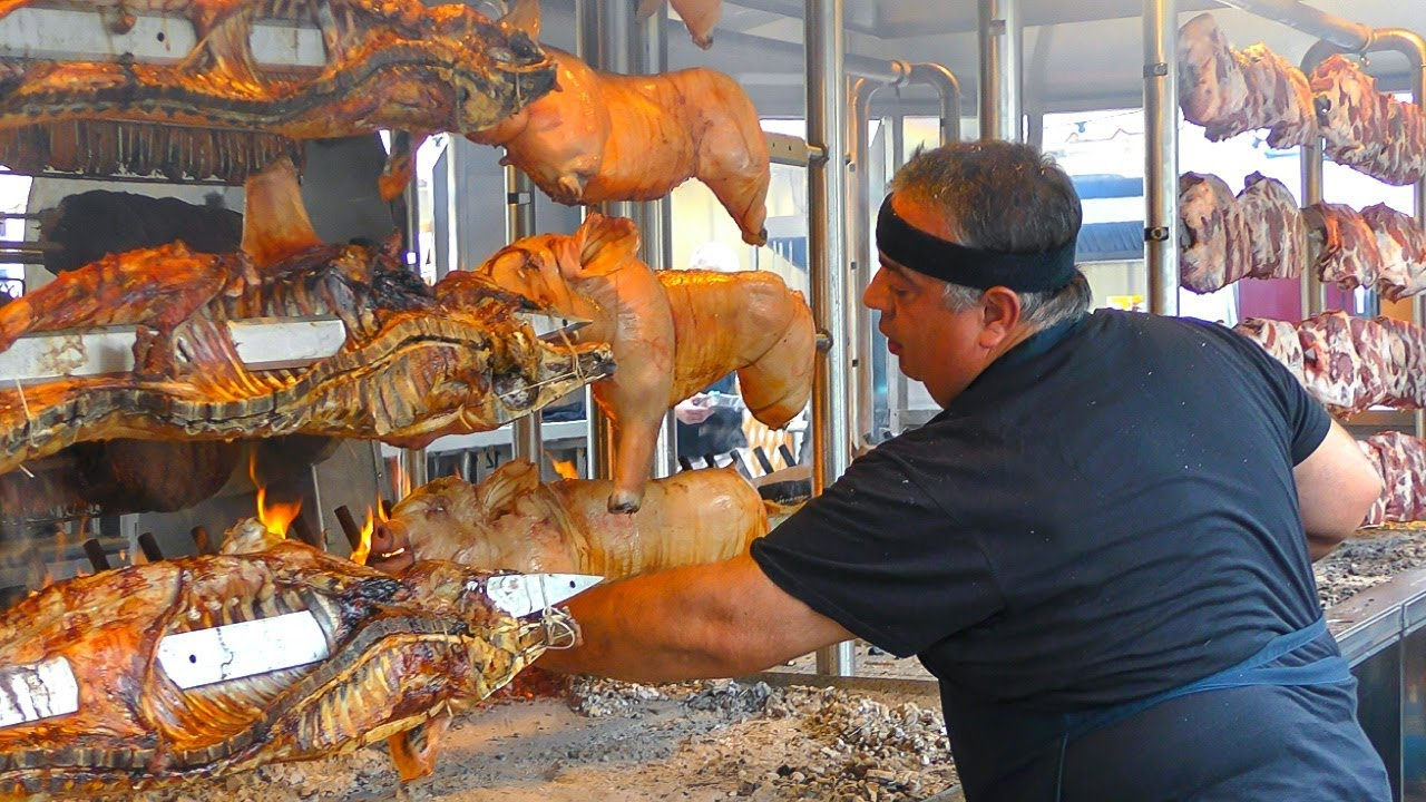 Huge Machinery Roasts Tons of Ribs and Pork. Italy Street Food