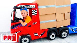 Vlad e Nikita fingem brincar com caminhões para crianças