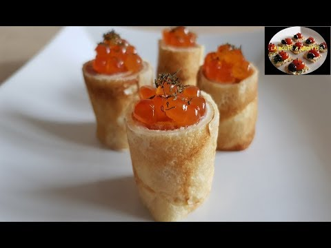 Rolls of pancakes with smoked trout - cocktail aperitif