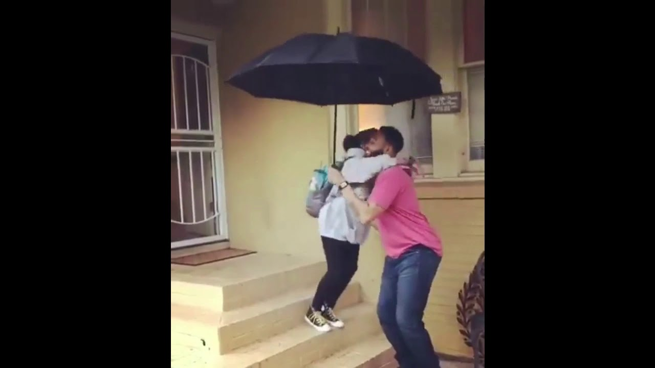 Black Father gets children safely to care in rain one by one