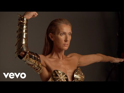Behind-the-scenes of the Courage album photoshoot: Gold metal corset by Thierry Mugler