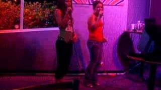 Cindy and Rachelle doing karaoke at Tokyo Fros