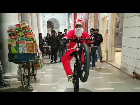 Santa Riding Bicycle in Market| Public Reactions |  Christmas | Too Funny