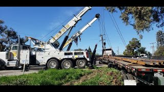 Pepe's Tow winching out a tractor with a loaded 80' trailer