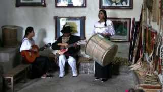 Ecuador Indian Family make and play musical instruments.mp4
