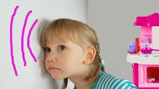 Alena and mom play with colorful tires and go through the wall