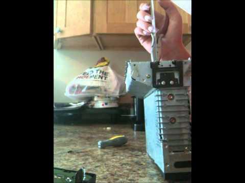 D.I.Y HOW TO REMOVE A CD OUT OF A FACTORY FORD RADIO